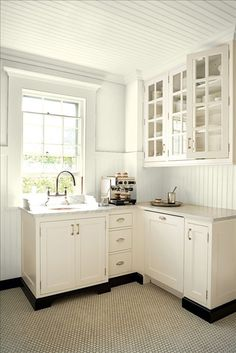 Benjamin Moore Ancient Ivory..lovely simple kitchenette with the essential component…an expresso!