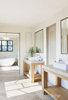 Limestone is key to making these bathrooms feel luxurious and serene.
