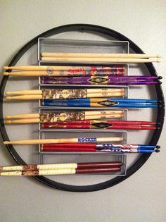 My son has a collection of drumsticks that I wanted to display somehow in the music room.  This was my final product.  The hoop, around the sticks, is an antique Ludwig bass drum hoop.