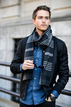 Fall / Winter - street style - casual style - black leather jacket + dark denim shirt + black pants + navy and white stripped scarf + black sunglasses