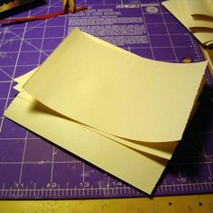 Little Leather Book made by Ruth Bleakley - Here are some pages stacked and ready for folding