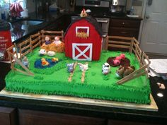 Two 13x18 sheet cakes covered in Buttercream as farmland.  Mud made of chocolate icing, pond out of Wilton Sparkle Gel.  Barn and Silo made of RKT covered in Fondant.  All Animals(rooster, pigs, sheep, horse, cow, goat, ducks and bunnies) handmade of fondant.  Birthday Kids made of fondant playing in hay. Fencing made of Gumpaste.  First time making fondant figures and RKT buildings so glad it worked out.