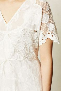 Pretty lace dress from Anthropologie. Would be fun to use vintage table linens to make a top with lace sleeves.