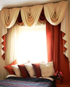 The pillows that match the formal swag look so nice. I love how the red orange and the cream look together!