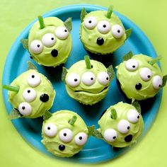 "Toy Story Green Alien Cupcakes   What you'll need: Cupcakes, White frosting, Neon green food coloring   Mint-flavored chewable candies (found packaged in rolls)   Green apple sour belts  Green apple sour straws, cut into 2"" pieces   Black decorator gel icing   Kitchen shears, or a small leaf shaped fondant cutter"