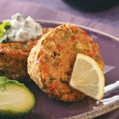 """Baked Salmon Cakes Recipe - """"Baked in muffin pans and served with sauce on the side, these cute cakes make a fantastic light meal. You can also bake a double batch and freeze some for a quick, healthy supper later in the month. Fish Dishes, Seafood Dishes, Seafood Recipes, Cooking Recipes, Healthy Recipes, Main Dishes, Great Recipes, Dinner Recipes, Favorite Recipes"""