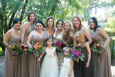 Neutral taupe bridesmaid dresses allowed the bright florals by Petalworks to shine.