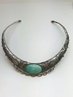 """Beautifully detailed sterling silver collar necklace with large bezel oval shaped blue-green turquoise.  The sterling can be shaped to fit.  Necklace is stamped """"Sterling"""" and weighs 62.0 grams   Shop this product here: http://spreesy.com/blingitaround/4   Shop all of our products at http://spreesy.com/blingitaround      Pinterest selling powered by Spreesy.com"""