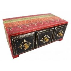 """Jewelry is an ornament for the body, but it can be kept in something other than a """"hum drum"""" and boring box. Flooded with the many classic colors of this remarkable region, this authentic mango wood box features three perfectly sized drawers for all of your treasures. Generations of artisans still dedicate themselves to hand crafts in this area of the country, and with one look at this box you will know it comes straight from the """"land of the kings""""."""