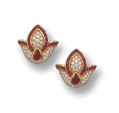 Exquisite tulips, studded with rubies and diamonds forms a classic pair of ear studs, handcrafted in 18k yellow gold.