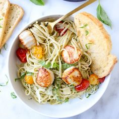 Pesto Linguine with Scallops and Blistered Tomatoes - the perfect summer pasta dish. Sweet and succulent scallops and atop pesto