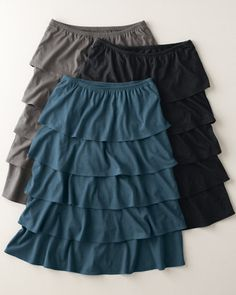 Soft and fluid in a cotton/modal blend, our skirt is constructed with an elastic waist and layered tiers that fall to just below the knee. Imported.