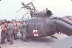 """Vietnam War: There was no more welcomed sound of to a wounded soilder in Vietnam than the whop-whop-whop of the """"dustoff Huey"""" coming to get them out of hell. Anyone that has ever flown in a Dustoff Huey will n… Vietnam History, Vietnam War Photos, Combat Medic, My War, War Image, Navy Military, Military Helicopter, United States Army, American War"""