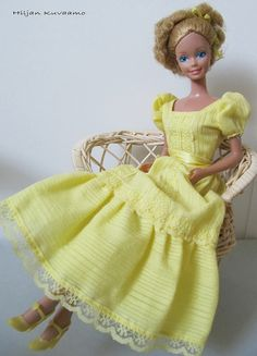 my sister and i had SO many of the barbies and dresses from this set of photos!! blast from the past