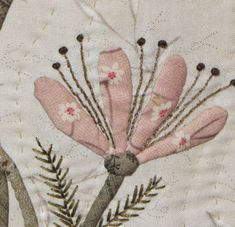 Close up detail of needle turn applique and hand embroidery by Lenna Green of Little Green Cottage, Discover more at stitchingcow.com