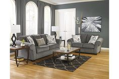"""The Makonnen Sofa from Ashley Furniture HomeStore (AFHS.com). The """"Makonnen-Charcoal"""" upholstery collection takes fresh contemporary design and adds the comfort of oversized rolled arms and plush seating and back cushioning all wrapped within a stylish and soft upholstery fabric creating the perfect furniture collection to complete the décor of any living space."""