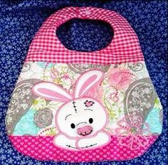 This is an in-the-hoop machine embroidery design for a baby bib with a cute bunny applique on it. The quilting is also done in the hoop. Comes in two sizes for the and hoops. Both sizes are included with your purchase. Embroidery Hoop Nursery, Baby Embroidery, Embroidery Flowers Pattern, Embroidery Works, Embroidery Monogram, Learn Embroidery, Hand Embroidery Designs, Applique Designs, Bib Pattern