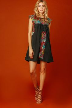Our heart belongs to the Vista Hermosa  Embroidered Dress! Breezy cotton fabric, in a lovely black hue, forms a sleeveless smock dress with multi color floral e