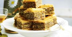 Many Middle Eastern countries consider baklava their own traditional dessert. We're not sure where it was originally invented. We're just glad to experience the sweet flaky goodness. Cheesecake Toppings, Baked Cheesecake Recipe, How To Make Cheesecake, Cheesecake Brownies, Square Cake Pans, Square Cakes, How To Make A Poached Egg, Baklava Recipe, Decadent Chocolate