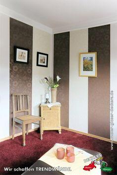 Tapezierarbeiten mit Mustertapetenstreifen in Zimmer mit rotem Teppich durch den Fachbetrieb Maler & Glaser Deckers in Issum (47661) | Maler.org