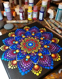 This completed harmonious mandala painting made on decorative wooden plate with brush and lovely acrylic pastel paints. It's a pleasure for eyes – to zoom in and out the gentle dot-painted souvenir for not missing any detail. This handmade piece of art ha Dot Art Painting, Mandala Painting, Stone Painting, Mandala Canvas, Crafts To Make And Sell, Sell Diy, Mandala Rocks, Mandala Pattern, Pebble Art