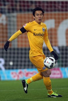 Makoto Hasebe (#20) of Frankfurt in action during the Bundesliga match between FC Augsburg and Eintracht Frankfurt at WWK Arena on December 4, 2016 in Augsburg, Germany.