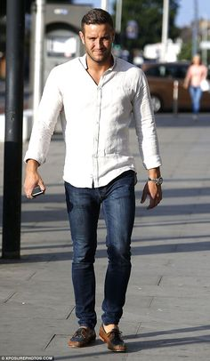 Dapper dude: Elliot Wright played it cool in a crisp white shirt and denim jeans...