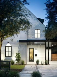 HGTV loves this modern take on a traditional white farmhouse with unique black metal accents, updated landscaping, and a covered entrance with lighting. White Farmhouse Exterior, Modern Exterior, Exterior Design, Modern Barn House, Modern House Design, Modern Cottage, Residential Architect, Modern Architects, Facade House