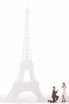 Perfect surprise proposal in front of the Eiffel Tower #parisengagement…