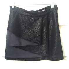 "BCBG black mini skirt NWOT This black mini skirt has never been worn. The front has a ""folding fabric"" effect. Back has a visible zipper and a hidden hook and eye clasp. BCBGeneration size 6, but runs small. Really fits like a 2-4. Machine wash or dry clean. BCBGeneration Skirts Mini"