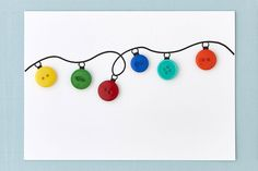 DIY holiday card: Button string lightsDIY holiday card: Button string lights—Create the magic of holiday lights on a card with this cute-as-a-button craft.DIY Christmas Craft Ideas - A Little Craft In Your DayDIY Christmas Craft Button Christmas Cards, Diy Holiday Cards, Christmas Card Crafts, Button Cards, Homemade Christmas Cards, Holiday Crafts, Diy Homemade Cards, Christmas Cards Handmade Kids, Christmas Buttons