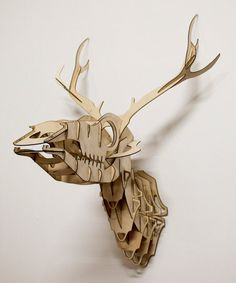 """Goldfuss - plywood taxidermy skull deer trophy - Goldfuss is a 3D puzzle of a skeletal deer trophy , which comes flat packed and consists of several laser cut birch plywood pieces that slot in to each other. Named after paleontologist and zoologist Georg August Goldfuss.  Approximate dimensions: Height: 25"""" - 63cm, Width: 18"""" - 45cm, Depth: 16"""" - 40cm, Made in Hackney Wick, London"""