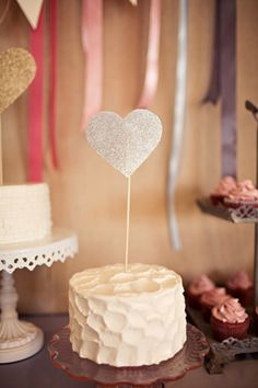 I really like the 2 layer cakes set on different cake platters. I'm starting to dig the idea of a dessert bar....