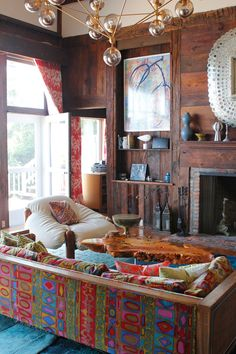 Stunning throw back boho modern living space! Patterned couch is to die for!