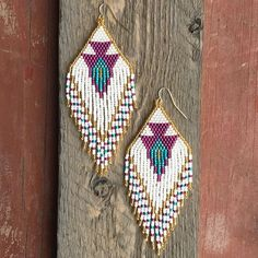 ||Fringe Beaded Earrings|| >>Arrowhead pattern, 4 inches long, made with glass seed beads and .925sterling silver ear wires. DM for purchase #handmade #beads #earrings #jewelry #seedbeads #beading #earring #original #unique #beadwork #seedbeadearrings #jewelrydesigner #handcrafted #fashion #trend #utahartist #saltlakeartist #beautiful #slc #saltlakecity #utah #buylocal #localartist #jewelrydesign #dangleearrings #creative #sterlingsilver #925 #seedbead #labyrinthbeadco