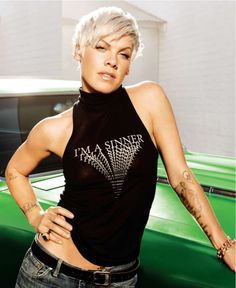 Pink -  I don't know much about her, but she seems smart & tough - I want to know more about her
