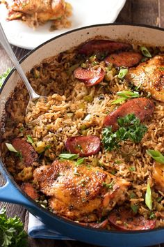 One Pot Chicken and Dirty Rice | Chicken thighs are cooked on top of a homemade dirty rice, which makes for the most flavorful Cajun-inspired dish you've ever had! Plus, all you need is one pot! | http://thechunkychef.com