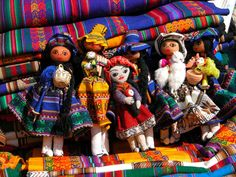 Dive into the local culture at the Pisac Market, where everything from traditional jewelry to Alpaca wool scarves to fresh fruits and vegetables can be found in colorful stalls.