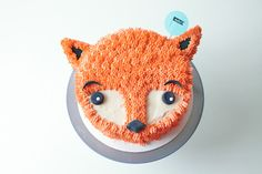 This sweet & easy-to-make furry fox cake is the perfect pal for a winter birthday party.