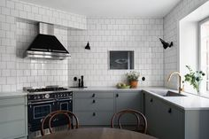 Green kitchen with white tiles