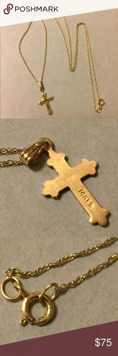 14k solid gold cross necklace Solid 14 K chain and cross. The chain is 16 inches long. Both chain and cross are marked 14 K Jewelry Necklaces