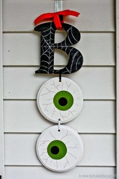 Halloween wall hanging for the indoors or outdoors; painted wood cut-outs. Stop by to see this super fun and easy BOO Halloween Door Hanging! Perfect for your as well as on a wall! JoAnn Fabric and Craft Store Coupon Boo Halloween, Diy Deco Halloween, Moldes Halloween, Adornos Halloween, Manualidades Halloween, Diy Halloween Decorations, Holidays Halloween, Diy Halloween Signs, Halloween Centerpieces