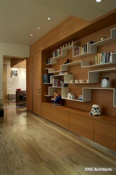 A bookshelf that is a piece of art in itself! #bookshelf #contemporary Design Courtesy - KNS Architects