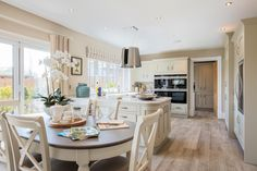 Convivial open plan living at it's best. Enjoy our stylish kitchens.