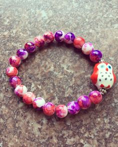 Hey, I found this really awesome Etsy listing at https://www.etsy.com/listing/474669781/red-owl-bracelet-red-and-purple-glass