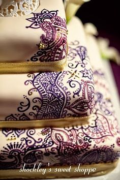 """""""An amazing cake for an amazing wedding. this Wedding Cake was hand-painted with various henna, mehndi patterns, adorned with gold dragees and ribbon. This cake was square that served Photograph courtesy of David Schwartz Photography. Henna Wedding Cake, Mehndi Cake, Indian Wedding Cakes, Purple Wedding Cakes, Henna Mehndi, Wedding Colors, Indian Cake, Indian Theme, Henna Party"""