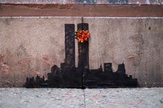 Banksy in New York: Twin Towers graffiti with orange flower - Respect for The deads !