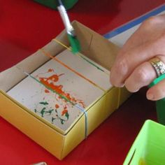 Kids painting activity. Paint rubber bands and snap onto paper (index cards)