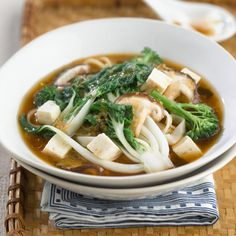 Rice noodle soup with mushrooms, pak choi and tenderstem broccoli
