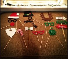 Handmade holiday photo booth props from foam sheets, chopsticks, hot glue and puff paint.